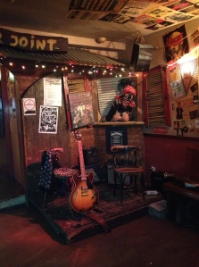 """The postage stamp sized """"stage"""" in the front bar at Maloe Melo"""