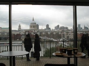 Me watching tourists watching the north bank of the Thames from the Tate Modern cafe
