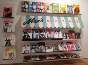 """Men's Magazines"" is a rack of fictionalized mags, many with pornographic themes"