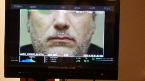 Close up of Lou's lips on the monitor for a very funny moment in the movie