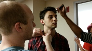 Ramon getting a make up touch up and his mic attached. (His character isn't sleeping which is why he looks like that!)
