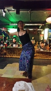 Bali dancer with rose petals