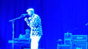 Buddy Guy singing passionately to the audience