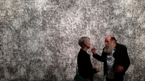 Ragna Robertsdottir in front of her wall mural made of shards of lava pumice