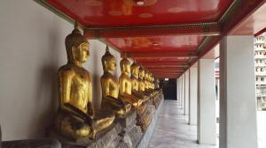 A line of serene buddhas sit in contemplation at the Wat Pho temple in the heart of Bangkok