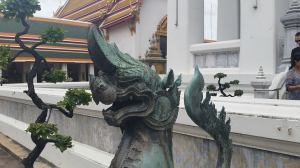 A mythological creature stands watch over one of the temples