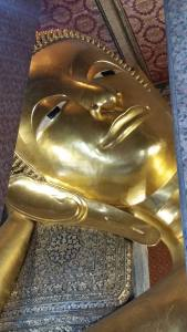 The head of an immense reclining Buddha at Wat Pho