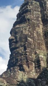 One incredible carved rock face five stories tall, at the Buddhist temple within Angkor Wat.